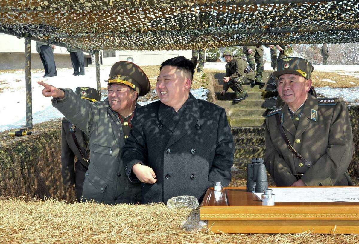 North Korean leader Kim Jong Un inspects a live-fire drill in a photo taken by the state-run Korean Central News Agency.