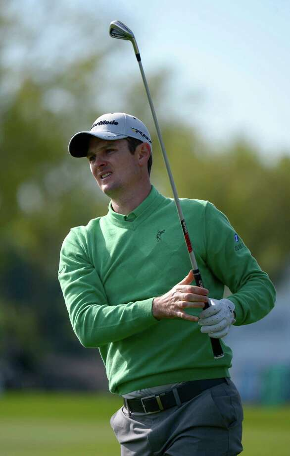 Justin Rose, of England, watches his shot from the 18th fairway during the first round of the Arnold Palmer Invitational golf tournament in Orlando, Fla., Thursday, March 21, 2013.(AP Photo/Phelan M. Ebenhack) Photo: Phelan M. Ebenhack