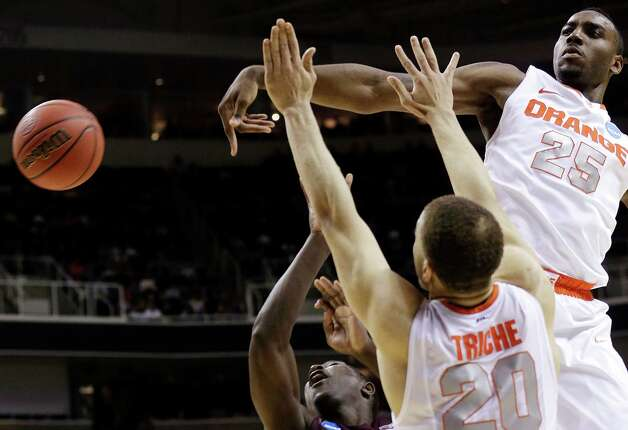 Syracuse 81, Montana 34Syracuse forward Rakeem Christmas (25) blocks a shot by Montana guard Will Cherry, bottom, as Syracuse's Brandon Triche (20) defends during the first half of a second-round game in the NCAA college basketball tournament in San Jose, Calif., Thursday, March 21, 2013. (AP Photo/Jeff Chiu) Photo: Jeff Chiu, Associated Press / AP