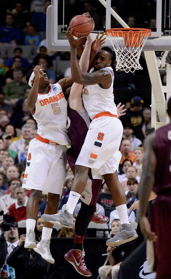 Rakeem Christmas #25 and C.J. Fair #5 of the Syracuse Orange go for a rebound against Eric Hutchison #45 of the Montana Grizzlies. Photo: Thearon W. Henderson, Getty Images / 2013 Getty Images