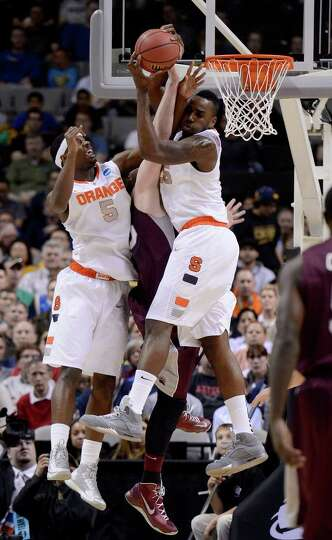 Rakeem Christmas #25 and C.J. Fair #5 of the Syracuse Orange go for a rebound against Eric Hutchison