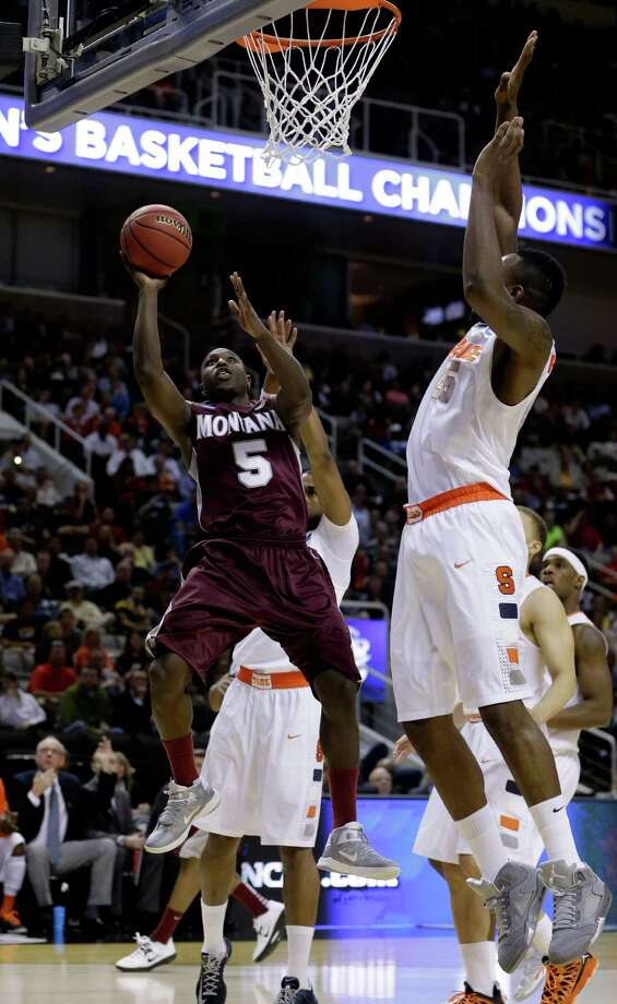 Will Cherry #5 of the Montana Grizzlies drives to the basket against Rakeem Christmas #25 of the Syracuse Orange in the first half. Photo: Ezra Shaw, Getty Images / 2013 Getty Images