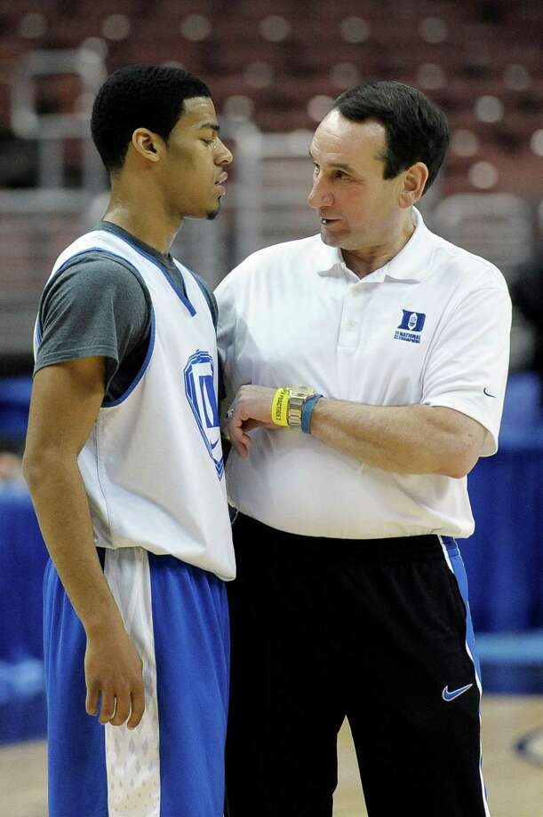 Duke head coach Mike Krzyzewski, right, talks with Quinn Cook during practice for a second-round game of the NCAA college basketball tournament, Thursday, March 21, 2013, in Philadelphia. Duke is scheduled to play Albany on Friday. (AP Photo/Michael Perez) Photo: Michael Perez