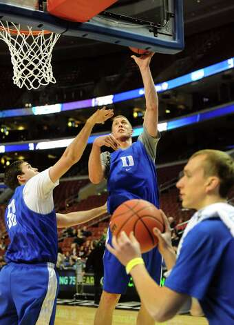 Duke's Mason Plumlee, center, shoots as Todd Zafirovski, left, defends during the NCAA Tournament open practice on Thursday, March 21, 2013, at Wells Fargo Center in Philadelphia, Penn. (Cindy Schultz / Times Union) Photo: Cindy Schultz