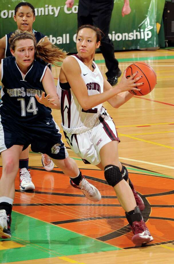 Ossining's Saniya Chong (12) drives against Gates-Chili's Samantha Heiler (14) in the New York State Public High School Athletic Association girls' Class AA basketball championship game in Troy, N.Y., on Saturday, March 16, 2013. (AP Photo/Hans Pennink) Photo: Hans Pennink / FR58980 AP