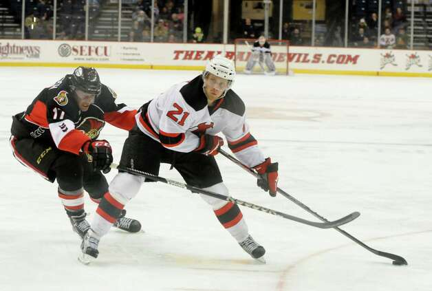 Mattias Tedenby of the Albany Devils, right, lines up a shot on the Binghamton Senators goal, Sunday evening, Jan. 6, 2013, during the second period at the Times Union Center in Albany, N.Y. Binghamton?s Patrick Wiercioch is pictured at left. (Will Waldron/Times Union) Photo: Will Waldron / 00020652B