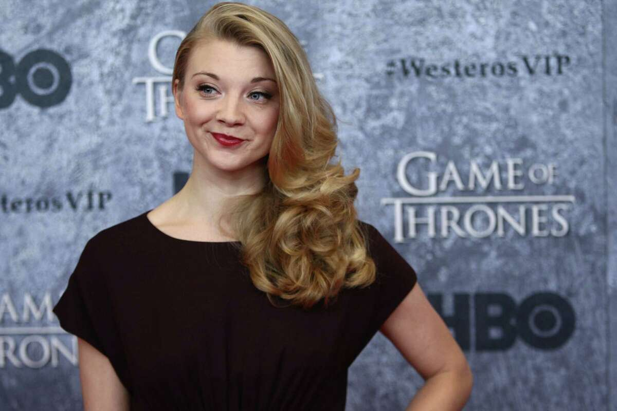 Natalie Dormer, who plays Margaery Tyrell, walks the red carpet during the Seattle premiere of season three of HBO's Game of Thrones at Seattle's Cinerama. Cast members attended a VIP screening at Cinerama and an after party at the Experience Music Project on Thursday, March 21, 2013.