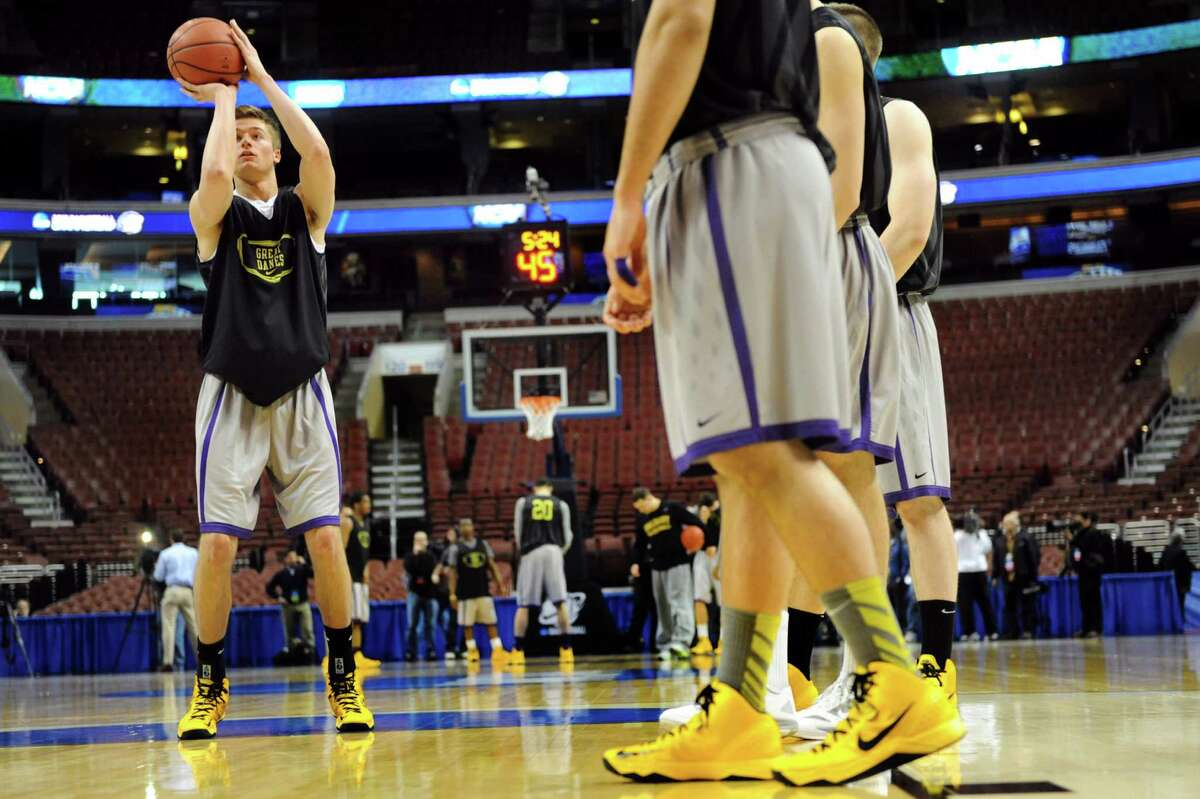 UAlbany's Dave Wiegmann, left, practices free throws during the NCAA Tournament open practice on Thursday, March 21, 2013, at Wells Fargo Center in Philadelphia, Penn. UAlbany plays Duke in the second round on Friday at 12:15 p.m. (Cindy Schultz / Times Union)
