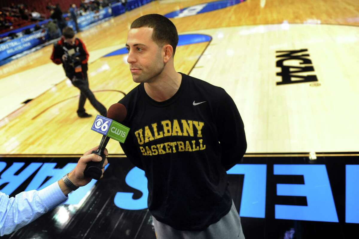 UAlbany's assistant coach John Iati talks with the media following the NCAA Tournament open practice on Thursday, March 21, 2013, at Wells Fargo Center in Philadelphia, Penn. Iati was part of the UAlbany team that played in the NCAA Tournament in 2006 and 2007. (Cindy Schultz / Times Union)