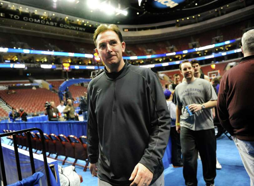 UAlbany's coach Will Brown leaves the court following the NCAA Tournament open practice on Thursday,