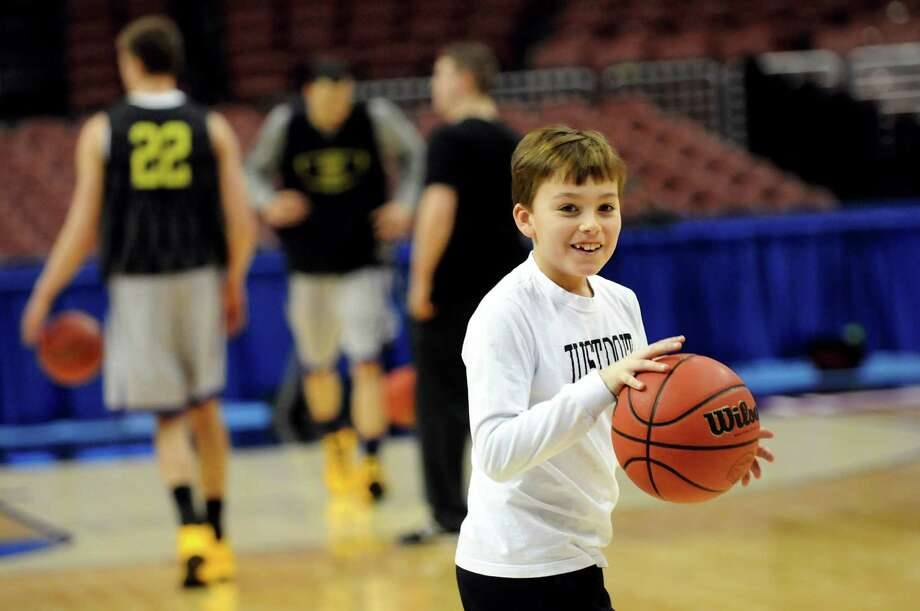 Jackson Brown, 10, son of coach Will Brown, plays hoops with the UAlbany team during the NCAA Tournament open practice on Thursday, March 21, 2013, at Wells Fargo Center in Philadelphia, Penn. (Cindy Schultz / Times Union) Photo: Cindy Schultz
