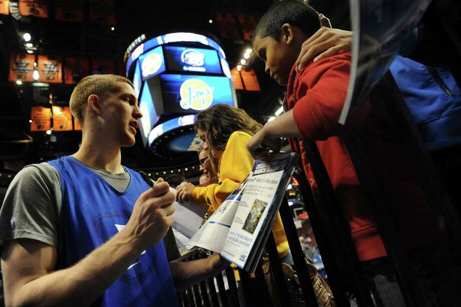 Duke's Mason Plumlee, left, signs autographs for fans after the NCAA Tournament open practice on Thursday, March 21, 2013, at Wells Fargo Center in Philadelphia, Penn. (Cindy Schultz / Times Union) Photo: Cindy Schultz