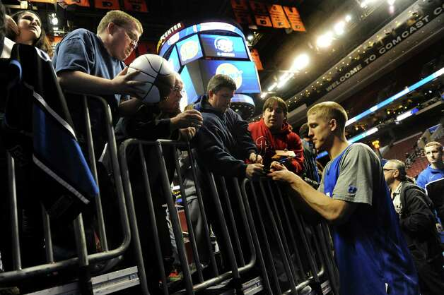 Duke's Mason Plumlee, right, signs autographs for fans after the NCAA Tournament open practice on Thursday, March 21, 2013, at Wells Fargo Center in Philadelphia, Penn. (Cindy Schultz / Times Union) Photo: Cindy Schultz