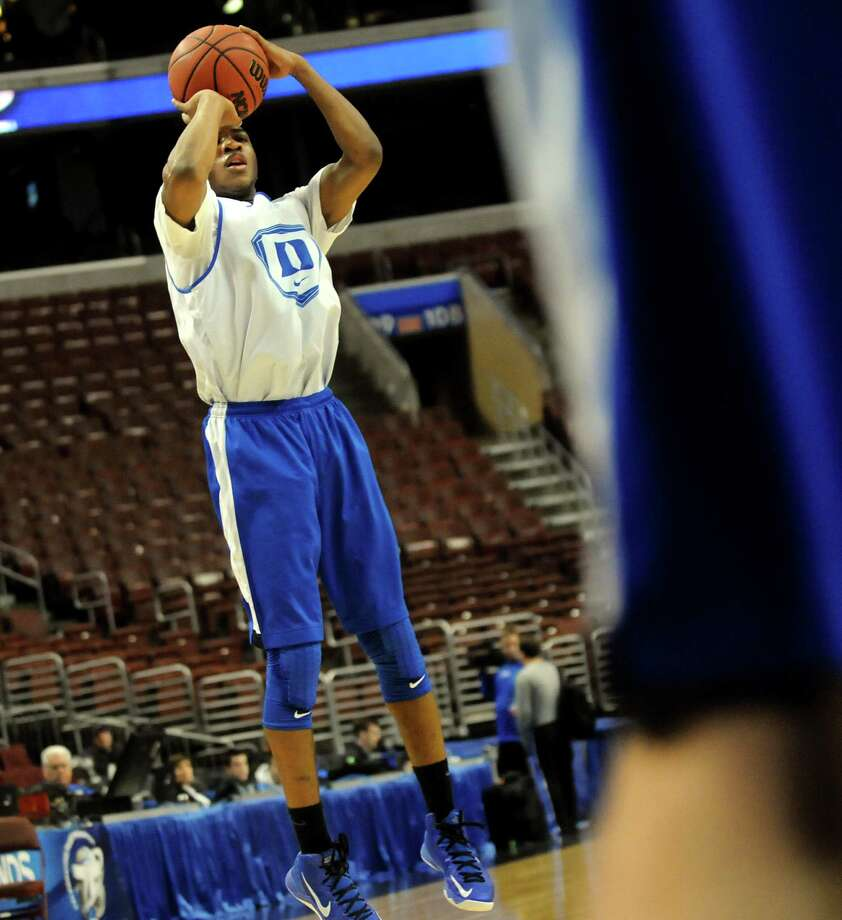 Duke's Rasheed Sulaimon, left, shoots for the hoop during the NCAA Tournament open practice on Thursday, March 21, 2013, at Wells Fargo Center in Philadelphia, Penn. (Cindy Schultz / Times Union) Photo: Cindy Schultz