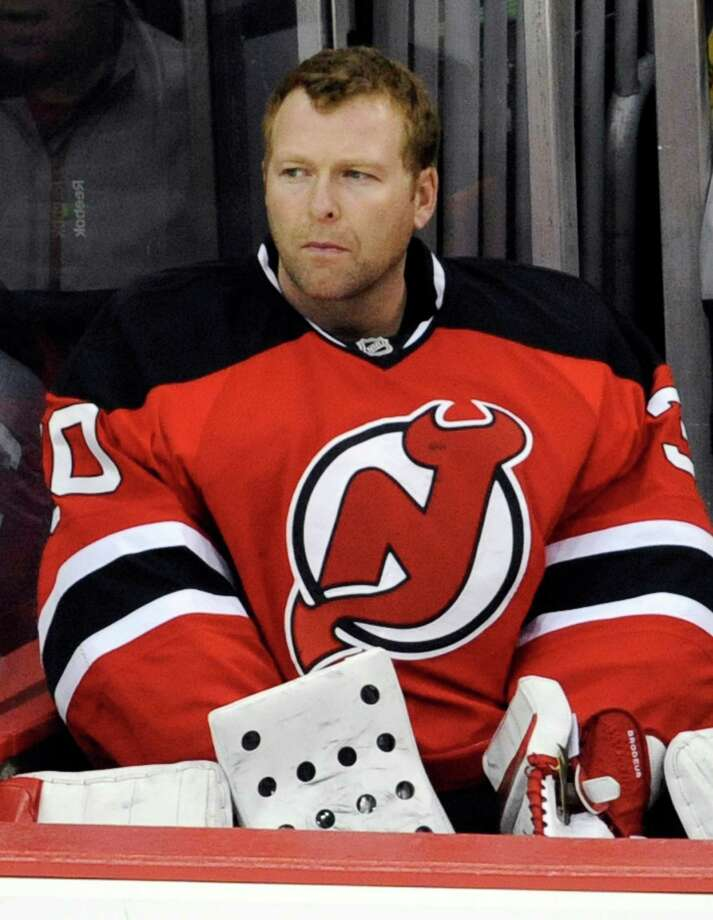 New Jersey Devils goaltender Martin Brodeur looks on from the bench during the third period of an NHL hockey game against the Winnipeg Jets Sunday, Feb. 24, 2013, in Newark, N.J. The Jets won 4-2. (AP Photo/Bill Kostroun) Photo: Bill Kostroun, FRE / FR51951 AP