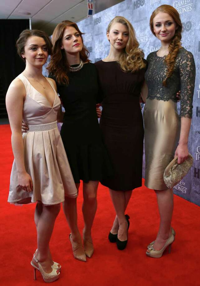 From left, Maisie Williams, who plays Arya Stark, Rose Leslie, who plays Ygritte, Natalie Dormer, who plays Margaery Tyrell, and Sophie Turner, who plays Sansa Stark, pose on the red carpet during the Seattle premiere of season three of HBO's Game of Thrones at Seattle's Cinerama. Cast members attended a VIP screening at Cinerama and an after party at the Experience Music Project on Thursday, March 21, 2013. Photo: JOSHUA TRUJILLO / SEATTLEPI.COM