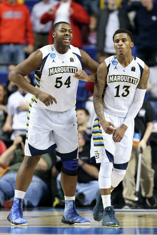 Marquette's Davante Gardner (left) and Vander Blue celebrate Blue's game-winning layup against Davidson. Photo: Andy Lyons / Getty Images