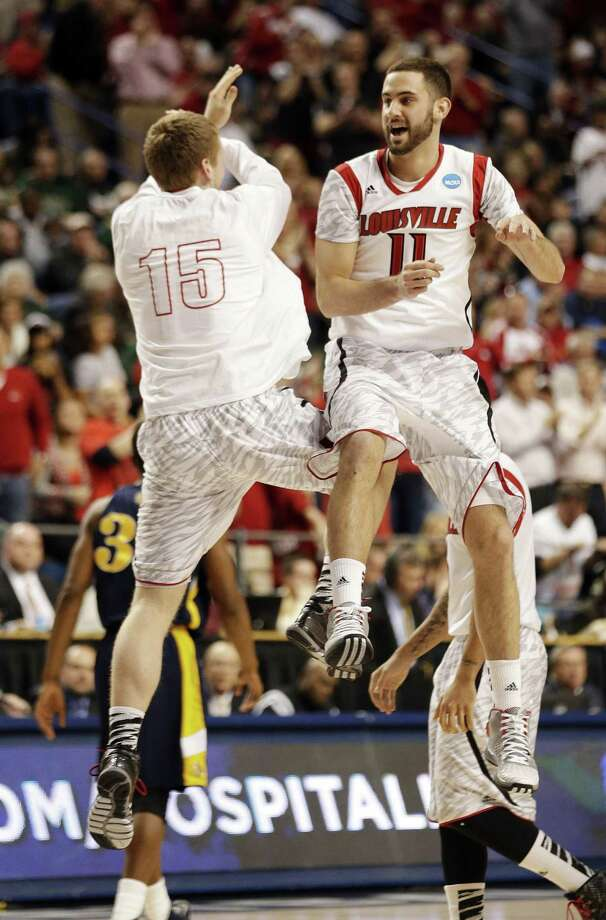 Louisville's Luke Hancock (right) and Tim Henderson have fun at North Carolina A&T's expense Thursday. Photo: John Bazemore / Associated Press