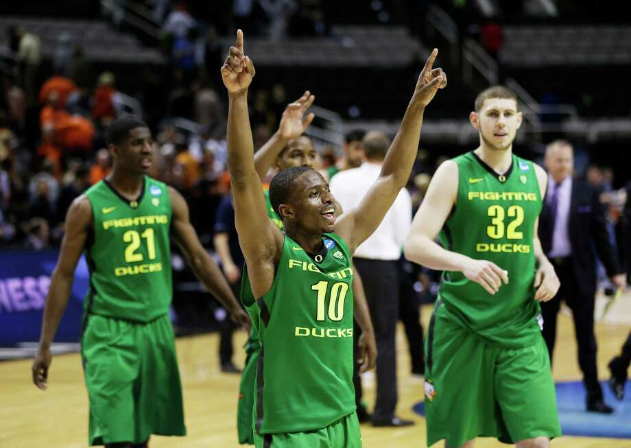 Oregon's Johnathan Loyd (10), Damyean Dotson (21) and Ben Carter (32) walk a little taller after their 68-55 victory over Oklahoma State on Thursday. Photo: Ezra Shaw, Staff / 2013 Getty Images