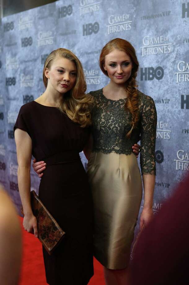 Natalie Dormer, who plays Margaery Tyrell, and Sophie Turner, who plays Sansa Stark, walk the red carpet during the Seattle premiere of season three of HBO's Game of Thrones at Seattle's Cinerama. Cast members attended a VIP screening at Cinerama and an after party at the Experience Music Project on Thursday, March 21, 2013. Photo: JOSHUA TRUJILLO / SEATTLEPI.COM