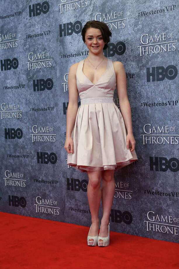 Maisie Williams, who plays Arya Stark, stops on the red carpet during the Seattle premiere of season three of HBO's Game of Thrones at Seattle's Cinerama. Cast members attended a VIP screening at Cinerama and an after party at the Experience Music Project on Thursday, March 21, 2013. Photo: JOSHUA TRUJILLO / SEATTLEPI.COM