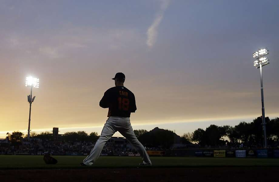 Matt Cain stretches at sunset in Scottsdale as he prepares for his start against Colorado in a night exhibition game. Photo: Marcio Jose Sanchez, Associated Press