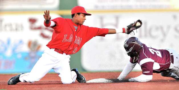 Lamar shortstop Sam Bumpers, left, looks on after tagging out Texas Southern's Marquis Curry in the top of the third inning Wednesday, March 13, 2013, at Vincent-Beck Stadium. The Cardinals won 8-1. Photo: Mike Tobias
