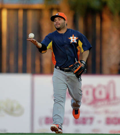 Astros second baseman Jose Altuve  tosses the ball to an umpire. Photo: Carlos Osorio, Associated Press / AP