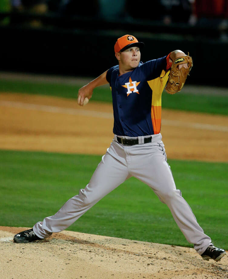 Astros relief pitcher Brad Peacock throws during spring training. Photo: Carlos Osorio, Associated Press / AP