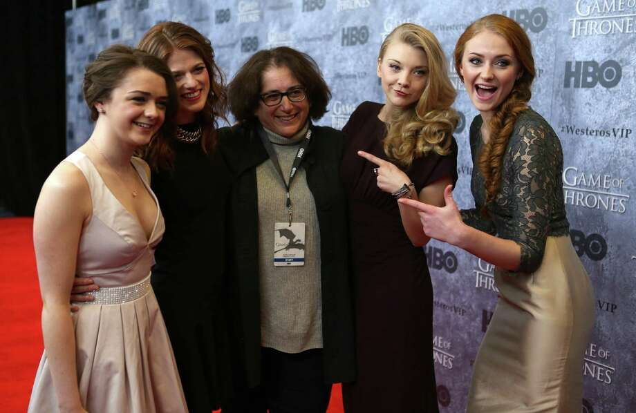 From left, Maisie Williams, who plays Arya Stark, Rose Leslie, who plays Ygritte, a member of the PR staff, Natalie Dormer, who plays Margaery Tyrell, and Sophie Turner, who plays Sansa Stark, pose on the red carpet during the Seattle premiere of season three of HBO's Game of Thrones at Seattle's Cinerama. Cast members attended a VIP screening at Cinerama and an after party at the Experience Music Project on Thursday, March 21, 2013. Photo: JOSHUA TRUJILLO / SEATTLEPI.COM