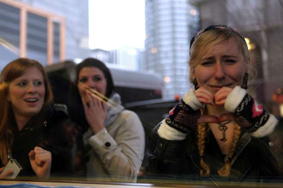 Fan Clara Lawryniuk, right, cries as she watches the cast of Game of Thrones through a window during the Seattle premiere of season three of the popular HBO show at Seattle's Cinerama. Cast members attended a VIP screening at Cinerama and an after party at the Experience Music Project on Thursday, March 21, 2013. Photo: JOSHUA TRUJILLO / SEATTLEPI.COM