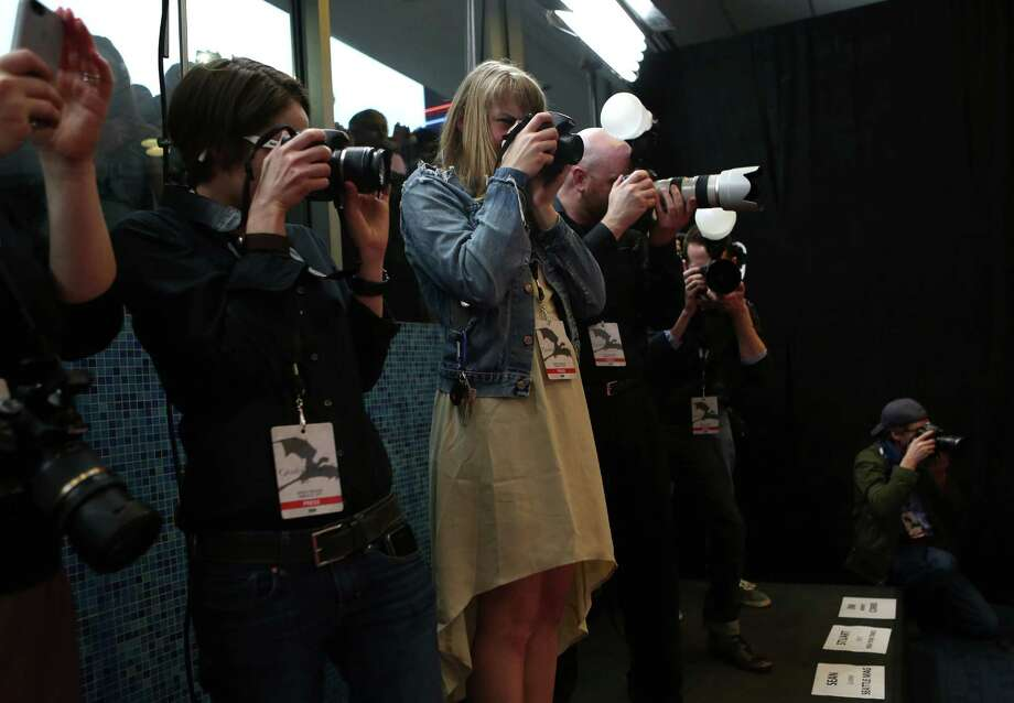 Photographers catch red carpet action during the Seattle premiere of season three of HBO's Game of Thrones at Seattle's Cinerama. Cast members attended a VIP screening at Cinerama and an after party at the Experience Music Project on Thursday, March 21, 2013. Photo: JOSHUA TRUJILLO / SEATTLEPI.COM