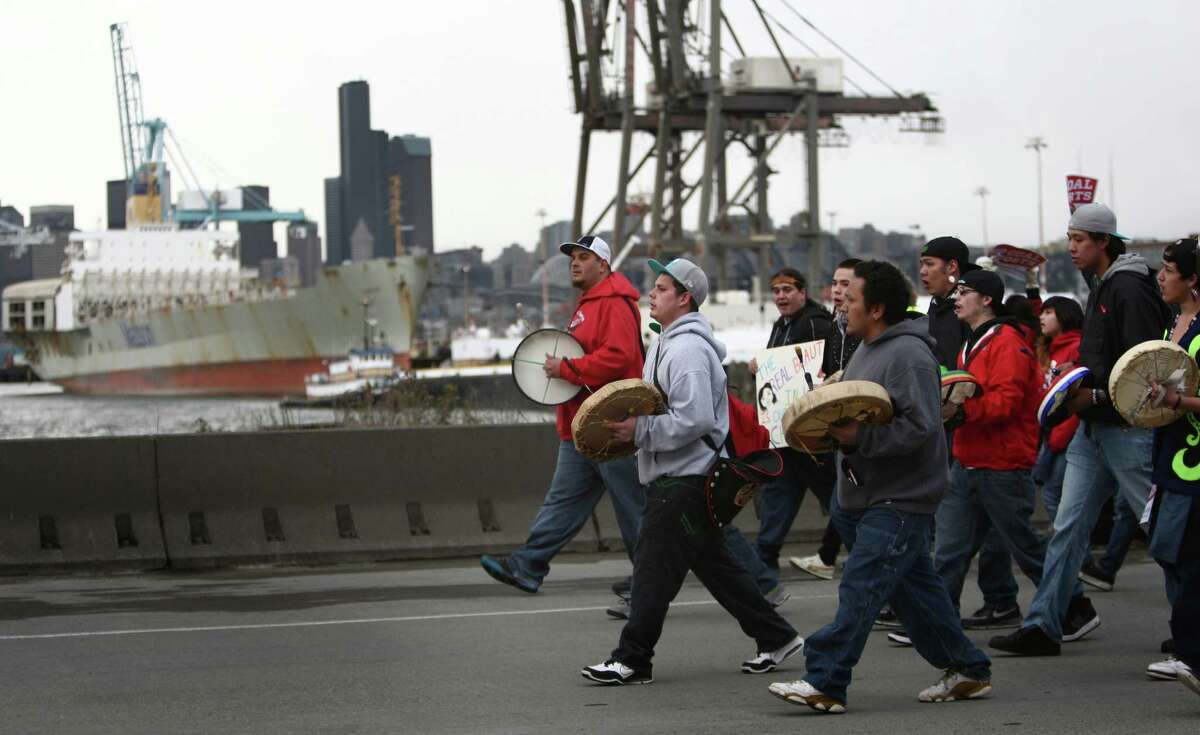 """Native drummers march on Seattle's Harbor Island during an """"Idle No More"""" rally and march on Thursday, March 21, 2013 in Seattle. The group was protesting the proposed export of coal to Asia. The group marched from Westlake Park to Seattle's Harbor Island. """"Idle No More"""" is a growing movement among Native Americans that started in Canada. They ask for respect of indigenous rights and treaties and hope to stop projects that could harm the environment."""