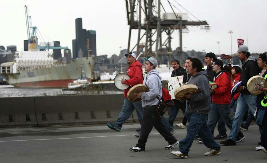 "Native drummers march on Seattle's Harbor Island during an ""Idle No More"" rally and march on Thursday, March 21, 2013 in Seattle. The group was protesting the proposed export of coal to Asia. The group marched from Westlake Park to Seattle's Harbor Island. ""Idle No More"" is a growing movement among Native Americans that started in Canada. They ask for respect of indigenous rights and treaties and hope to stop projects that could harm the environment. Photo: JOSHUA TRUJILLO / SEATTLEPI.COM"