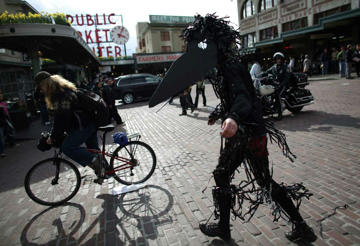 """A protester dressed as a bird marches during an """"Idle No More"""" rally and march on Thursday, March 21, 2013 in Seattle. The group was protesting the proposed export of coal to Asia. The group marched from Westlake Park to Seattle's Harbor Island. """"Idle No More"""" is a growing movement among Native Americans that started in Canada. They ask for respect of indigenous rights and treaties and hope to stop projects that could harm the environment."""