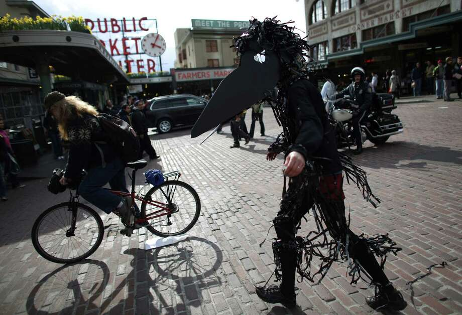 "A protester dressed as a bird marches during an ""Idle No More"" rally and march on Thursday, March 21, 2013 in Seattle. The group was protesting the proposed export of coal to Asia. The group marched from Westlake Park to Seattle's Harbor Island. ""Idle No More"" is a growing movement among Native Americans that started in Canada. They ask for respect of indigenous rights and treaties and hope to stop projects that could harm the environment. Photo: JOSHUA TRUJILLO / SEATTLEPI.COM"