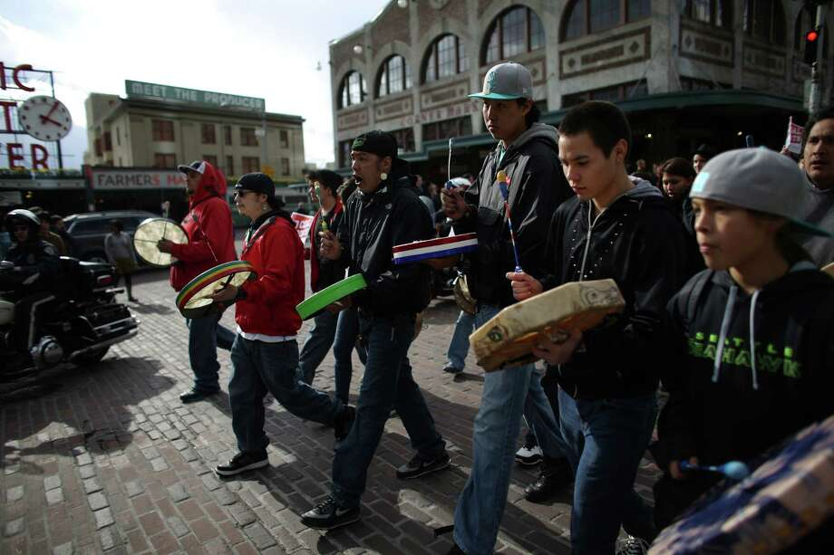 "Native drummers march during an ""Idle No More"" rally and march on Thursday, March 21, 2013 in Seattle. The group was protesting the proposed export of coal to Asia. The group marched from Westlake Park to Seattle's Harbor Island. ""Idle No More"" is a growing movement among Native Americans that started in Canada. They ask for respect of indigenous rights and treaties and hope to stop projects that could harm the environment. Photo: JOSHUA TRUJILLO / SEATTLEPI.COM"