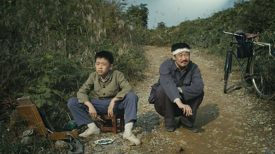 "Wang Han (Liu Wenqing) shares a moment with his father, Wang Han (Wang Jinchun), in ""11 Flowers."" Photo: First Run Features"