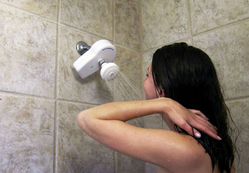Take short showers and turn the water off while washing.  Photo: Express-News/File