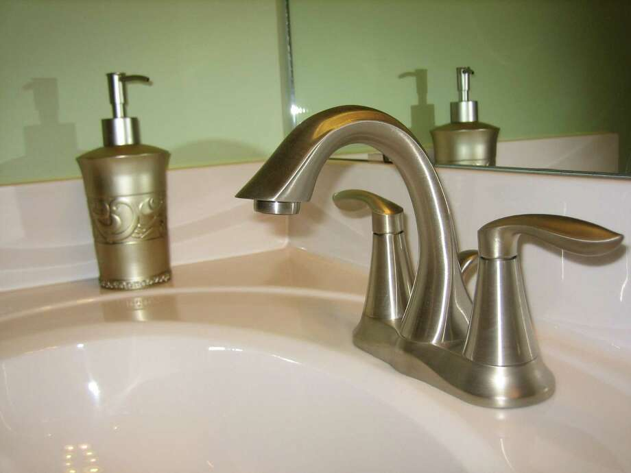 Repair dripping faucets promptly. Photo: Express-News/File