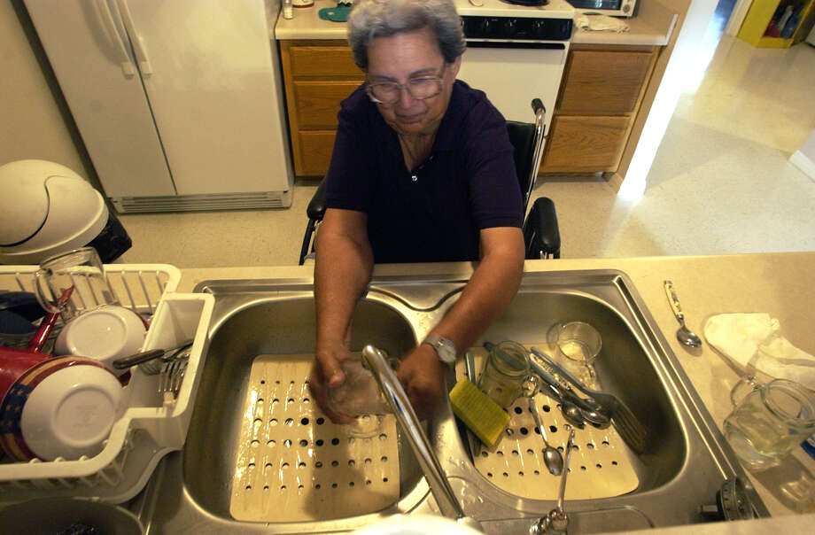 Scrape the dishes clean instead of rinsing them before washing. There is no need to rinse unless they are heavily soiled. Photo: JOHN DAVENPORT, Express-News/File / SAN ANTONIO EXPRESS-NEWS