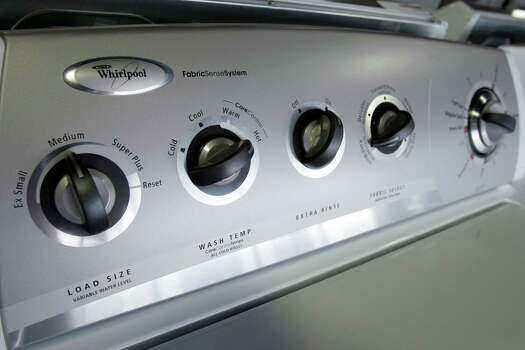 Whenever possible, use the lowest water-level setting on the washing machine for light or partial loads or laundry. Photo: Chris Gardner, Express-News/File / AP
