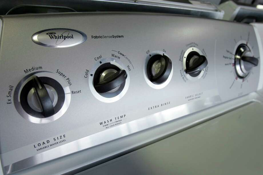 Wash laundry in warm or cold water and rinse in cold water. Photo: Chris Gardner, Express-News/File / AP