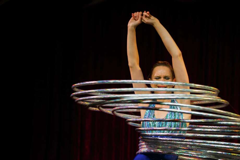 Hula-Hoop expert Maria Margiyeva spins and twirls her way through her performance on the opening night of the 10th annual Moisture Festival on Thursday , March 21, 2013, in Hale's Palladium at Hale's Ales in Seattle. The 