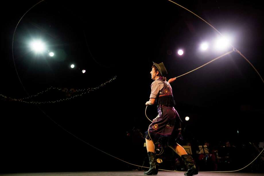 Karen Quest successfully completes her 50-foot lasso performance with zero causalities in front of a packed crowd on the opening night of the 10th annual Moisture Festival.   Photo: JORDAN STEAD / SEATTLEPI.COM