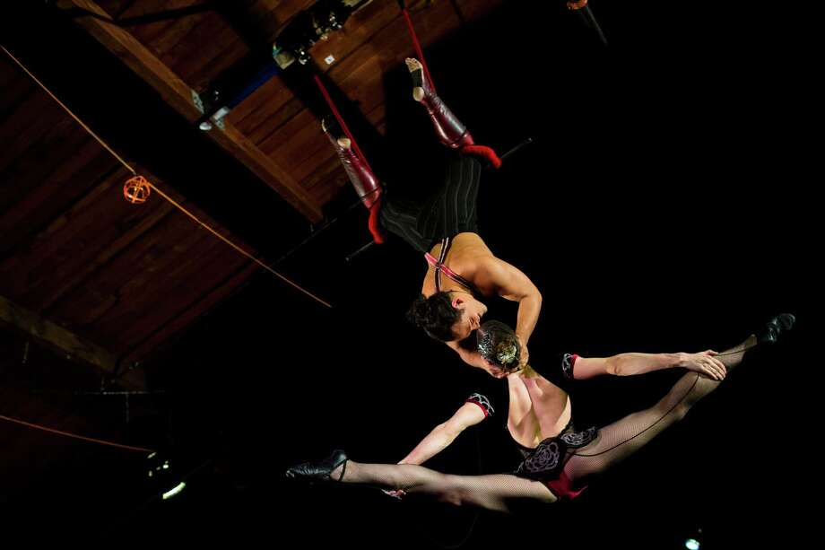 Samuel Johnson and and Sylvia Rose, of Duo Rose, perform on the trapeze on the opening night of the 10th annual Moisture Festival on Thursday , March 21, 2013, in Hale's Palladium at Hale's Ales in Seattle. The 