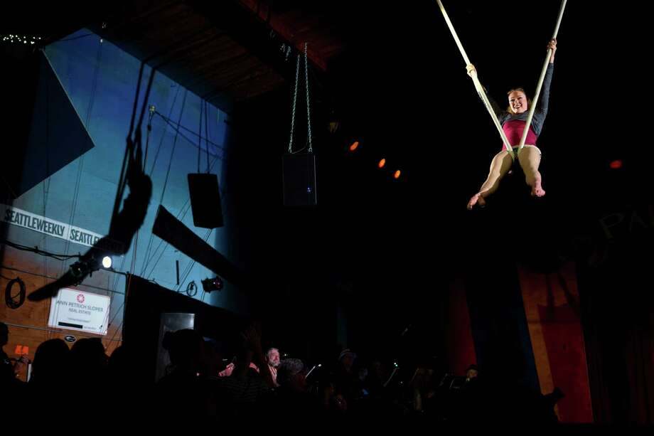 Aerialist Sally Pepper performs for a packed crowd on the opening night of the 10th annual Moisture Festival Thursday.  Photo: JORDAN STEAD / SEATTLEPI.COM