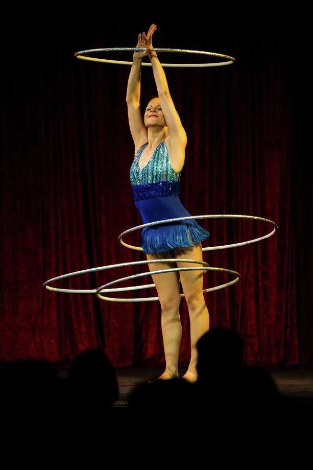 Hula-Hoop expert Maria Margiyeva spins and twirls her way through her performance on the opening night of the 10th annual Moisture Festival. Photo: JORDAN STEAD / SEATTLEPI.COM