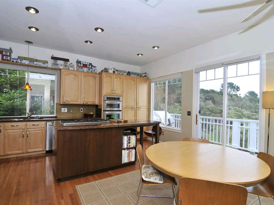 The kitchen h as a custom island, as well as granite countertops and stainless steel appliances.