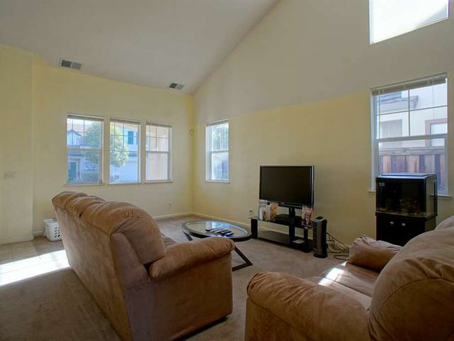 It features a sun-filled living room